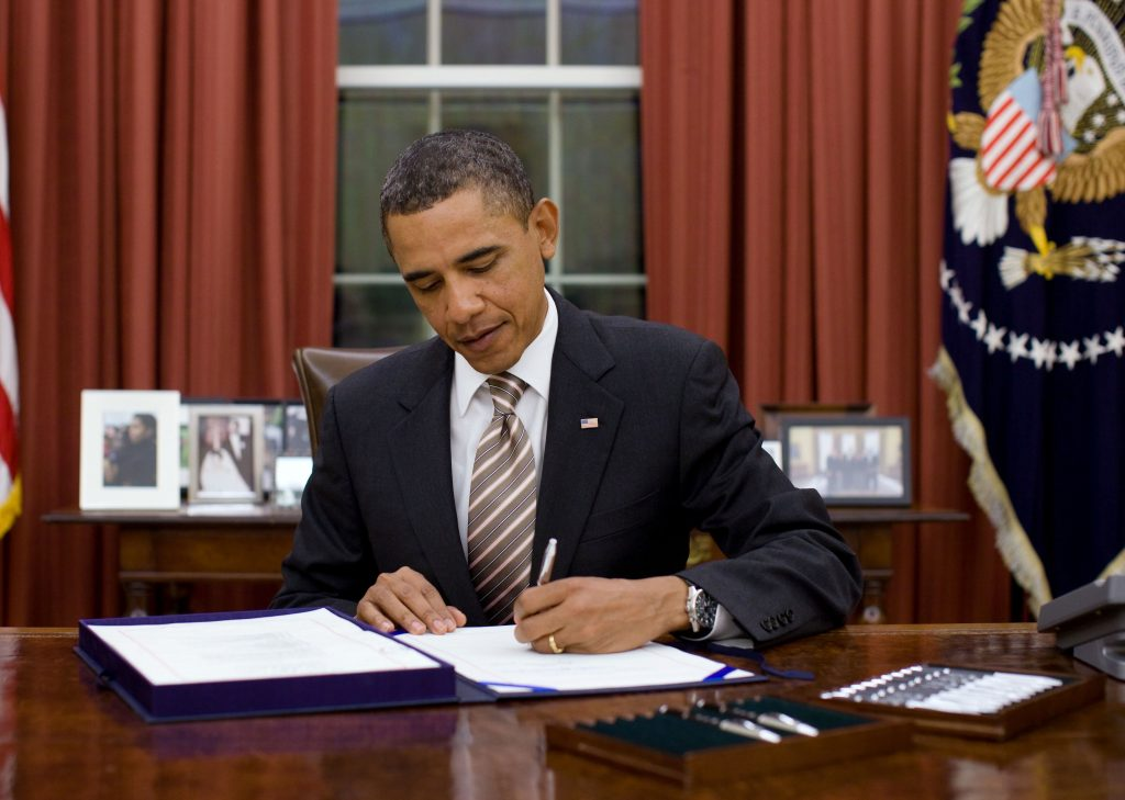 President Barack Obama signs H.R. 2751, the ÒFDA Food Safety Modernization Act,Ó in the Oval Office, Jan. 4, 2011. (Official White House Photo by Pete Souza) This official White House photograph is being made available only for publication by news organizations and/or for personal use printing by the subject(s) of the photograph. The photograph may not be manipulated in any way and may not be used in commercial or political materials, advertisements, emails, products, promotions that in any way suggests approval or endorsement of the President, the First Family, or the White House.